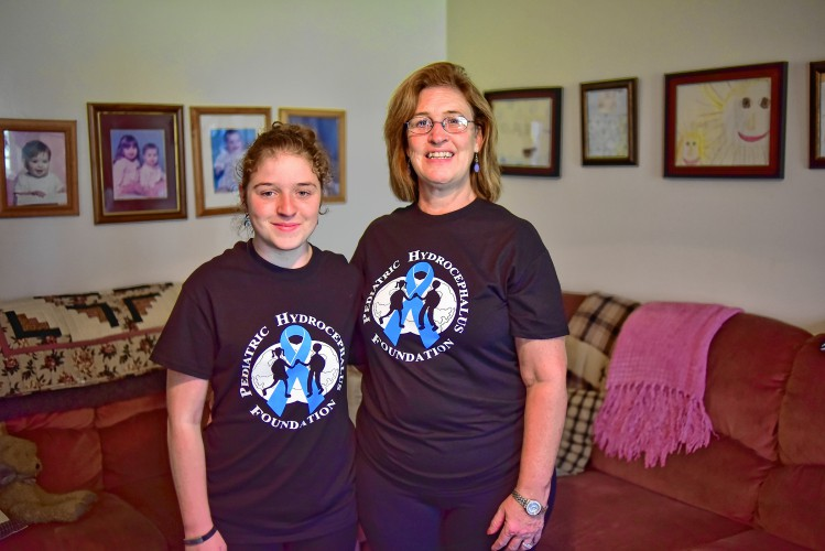 Bella Sacharczk, left, and her mother Denise Sacharzk pose for a photo Thursday, Sept. 22, in her home in Westhampton. Bella Sacharczk has hydrocephalus a condition in which fluid accumulates in the brain and on Saturday at Hampshire Regional High School they will be walking to raise awareness and money for research.